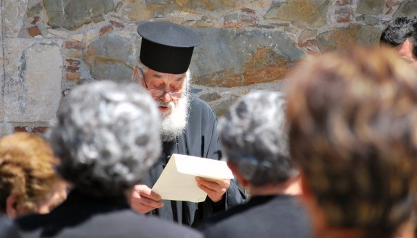 priest reading poem. August '09. Photo: Pavlos Iasonides. all rights reserved
