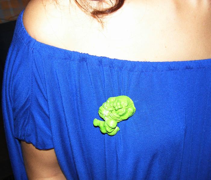 green pin on blue dress 0018213
